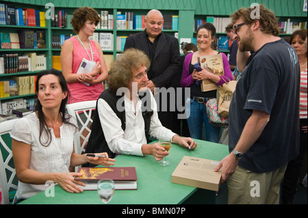 Queen guitarist Brian May pictured book signing in bookshop during Hay Festival 2010 Hay on Wye Powys Wales UK - Stock Photo