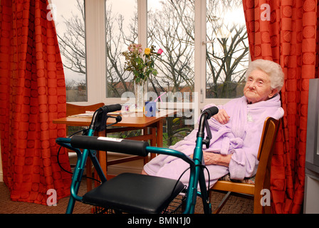 Elderly resident in her room at an old people's home, Wirral, UK. - Stock Photo