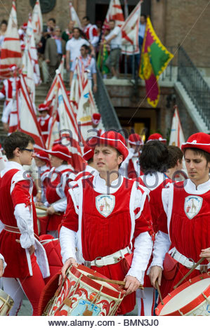 Residents of the Giraffa (Giraffe) contrada (district) of Siena rehearse for the annual Palio horse race, Siena, - Stock Photo