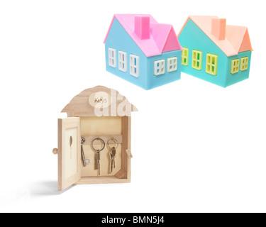 Key Box and Miniature Houses - Stock Photo
