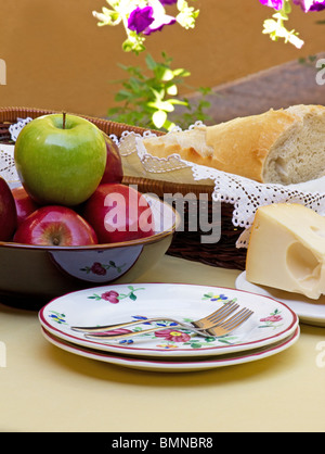 Table setting  with apples cheese and bread - Stock Photo