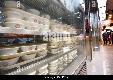 Dim sum on display lying in pile in Market in Hong Kong - Stock Photo