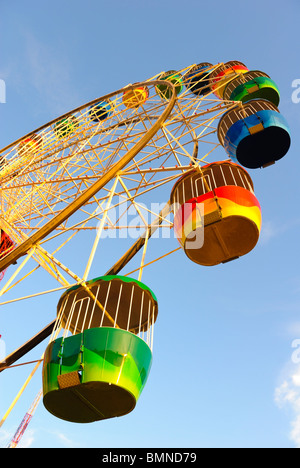 The colourful ferris wheel ride at the Luna Park amusement park, Sydney, Australia - Stock Photo
