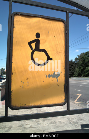 Yellow color handicapped road sign - Stock Photo