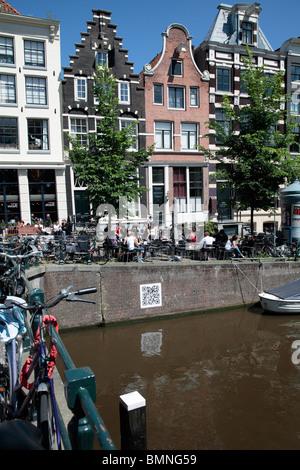 Homes bridge along Prinsengracht Amsterdam - Stock Photo