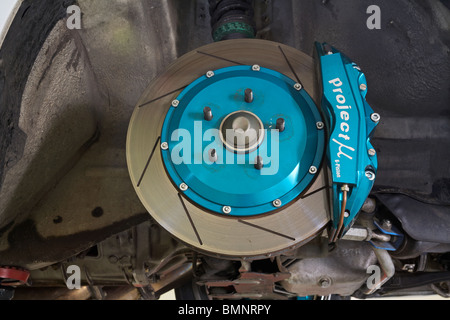 Brake disc (rotor) and calliper on a modified car - Stock Photo