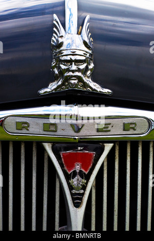 A Hood ornament of a viking on a vintage British Rover - Stock Photo