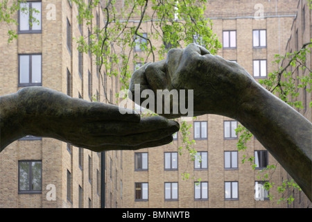 Sited on the east side of Berkley Square in London was Lorenzo Quinn`s sculpture `Give and Take`, yet another fine - Stock Photo