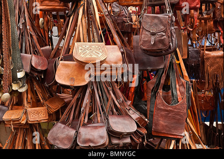 Leather goods for sale in an outdoor market, Madrid, Spain - Stock Photo