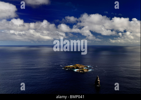 stunning view over the three islets of rapa nui from the top of the holy village of orongo on the south shores - Stock Photo