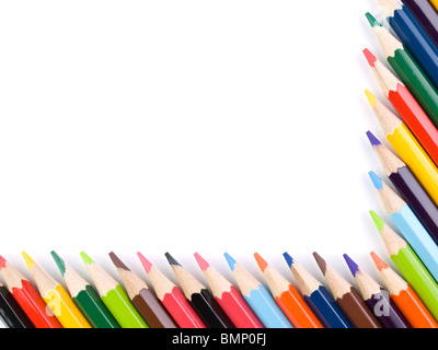 Colored pencils form a frame over a white background. Copy space. - Stock Photo