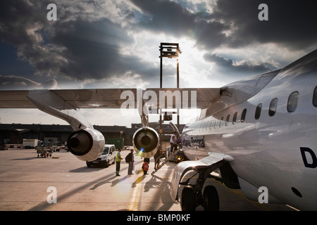 Passenger embark onto a Lufthansa Regional Airliner at Frankfurt International Airport - Stock Photo
