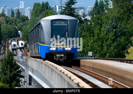 Vancouver, British Columbia, A Skytrain Rapid Transit Train Of The Trans Link Network Leaving Nanaimo Station - Stock Photo