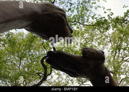 Fine sculpture titled `Give and Take` by the renown sculptor Lorenzo Quinn, the work was situated in Berkley Square, - Stock Photo