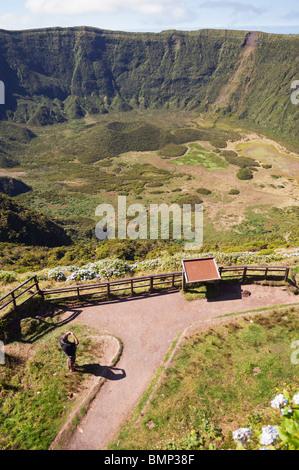 Tourists admiring Caldeira extinct volcano in Faial island, Azores, Portugal - Stock Photo