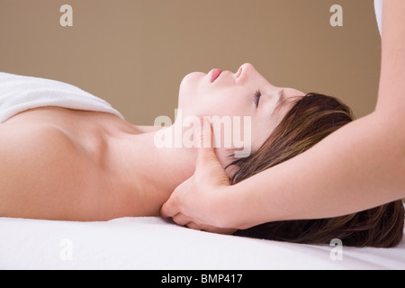Getting A Neck Massage From A Massage Therapist - Stock Photo
