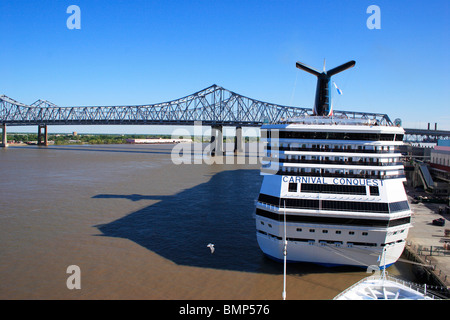 Cruise ship near the crescent city connection bridge over the Mississippi river, Twin cantilever bridges, New Orleans, - Stock Photo