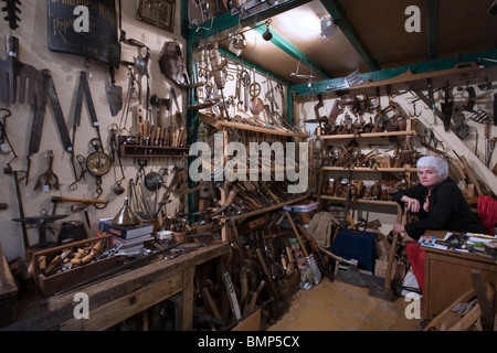 Vintage tools seller at the marche Dauphine, Paris - Stock Photo