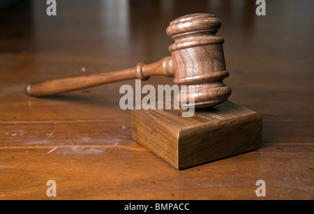 judges or auctioneers gavel on wooden table - Stock Photo