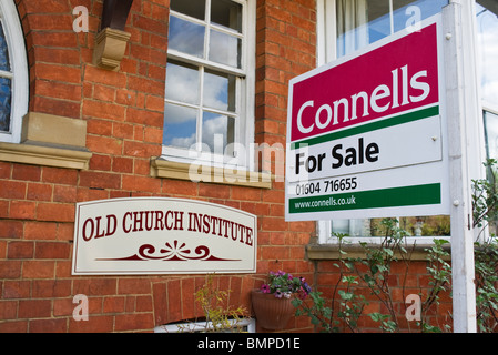 For Sale sign outside Old Church Institute in Kingsthorpe Northampton England UK EU - Stock Photo