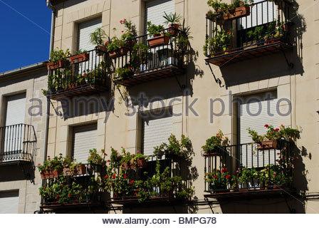 Flower filled balconies, Baeza, Jaen Province, Andalucia, Spain, Western Europe. - Stock Photo