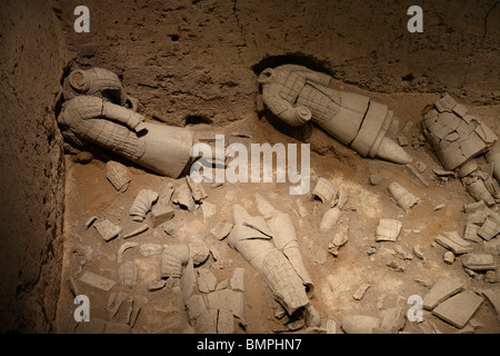 The Terracotta Army, Xi'an, China. The warriors are dug up in pieces and have to be reconstructed from many fragments. - Stock Photo