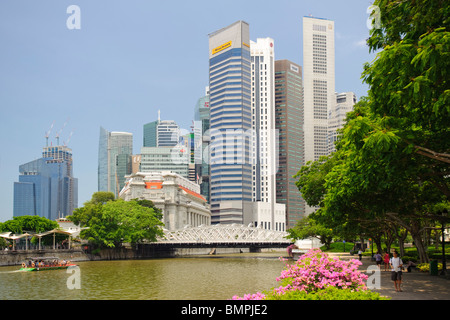 The Fullerton Hotel Singapore and Central Business District - Stock Photo