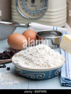 Ingredients Set Out For Making Scones, Flour, Butter, Eggs and Currants - Stock Photo