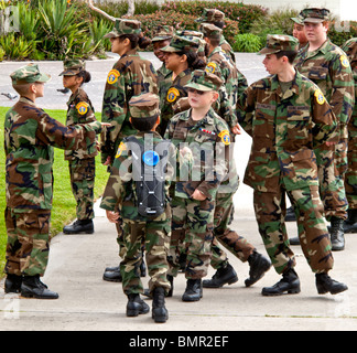 Interracial Young Marines wearing the 'Wood Pattern' Battle Dress Uniform in formation in Laguna Beach, California. - Stock Photo