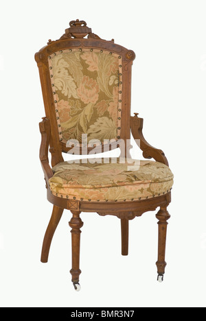 Eastlake Victorian period chair carved wood & upholstered. Front view isolated. - Stock Photo