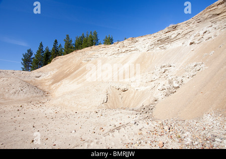 Erosion on a sandpit wall at a sandy ridge , Finland - Stock Photo