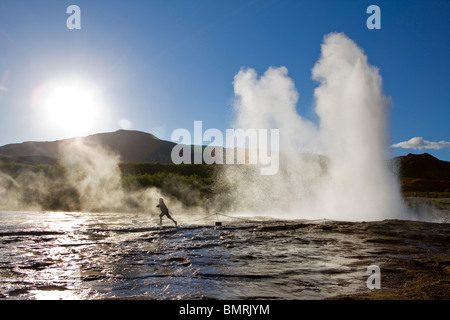Horse riding in Southern Iceland. Geysir hot springs - Stock Photo
