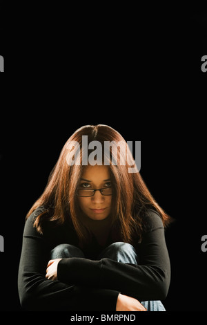 A Young Woman Looking Sad - Stock Photo
