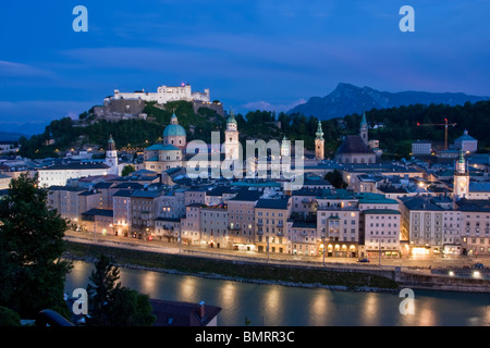 Salzburg Old town with the Kollegienkirche church, the cathedral and Festung Hohensalzburg fortress at dusk, Austria - Stock Photo