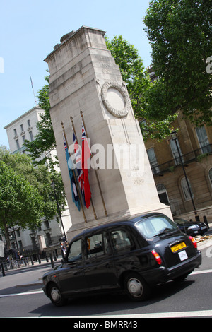 A London Taxi driving past the Cenotaph on Whitehall, Westminster, London, England, U.K. - Stock Photo