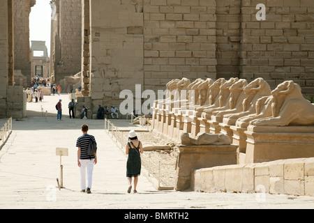 Tourists in Karnak Temple, Luxor, Egypt - Stock Photo