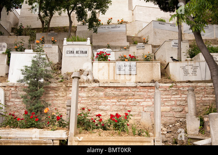 Graves in cemetery beside the Eyup Sultan Mosque, Eyup, Istanbul, Turkey - Stock Photo