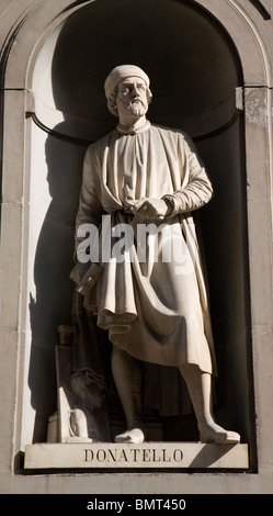 Florence - Doatello statue on the facade of Uffizi gallery by Girolamo Torrini. - Stock Photo
