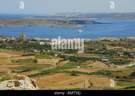 GOZO, MALTA. A view from Nadur over Mgarr to the island of Comino, and beyond to the Maltese mainland. 2010. - Stock Photo