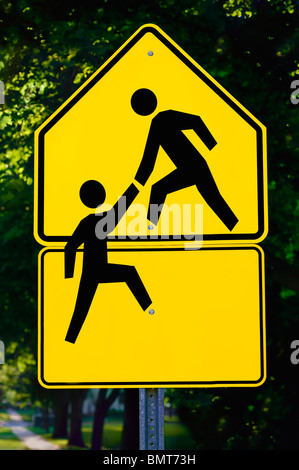 Willmar, Minnesota, United States Of America; Sign Showing A Person Helping Another Person - Stock Photo