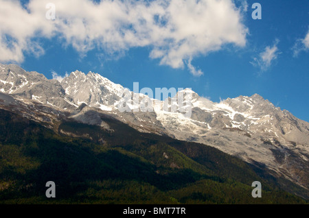 Summit Yulong Xueshan (Jade Dragon) Mountain near Lijiang Yunnan China - Stock Photo