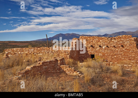 Reconstructed Puebloan village with Abajo Mountains in background at Edge of the Cedars State Park, Blanding, Utah, - Stock Photo