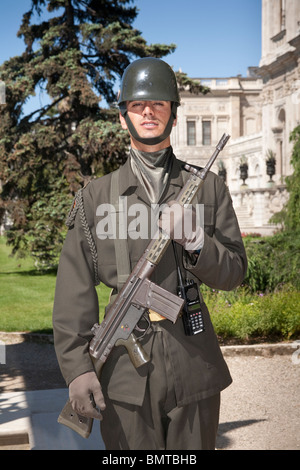 Armed soldier standing guard outside Dolmabahce Palace, Istanbul, Turkey - Stock Photo