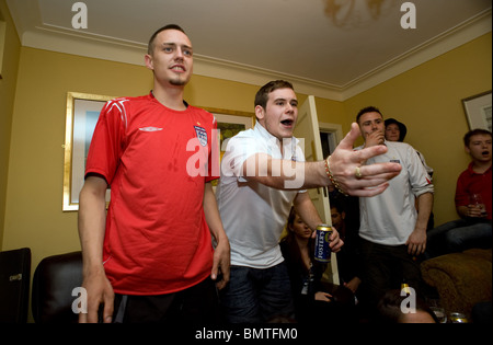 Frustrated England Fans in a freinds house watching  England vs Algeria World Cup Game - Stock Photo
