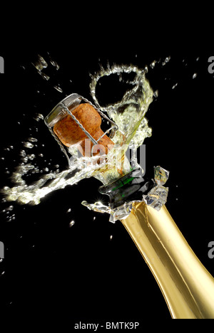 Extreme close-up of explosion of champagne bottle cork - Stock Photo
