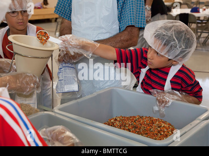 Muslim Volunteers Pack Food for Families in Need - Stock Photo