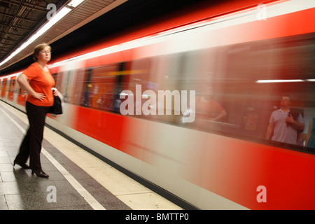 woman on platform of S-Bahn station - Stock Photo