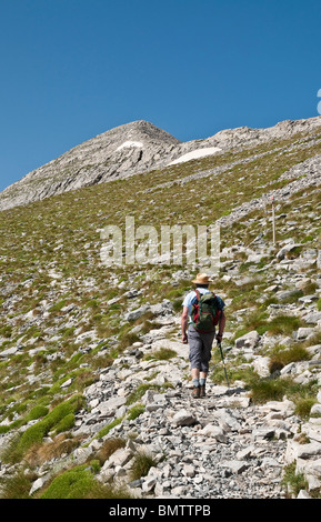 A walker on the path to the top of Profitis Ilias, at 2404 mtrs, the highest peak in the Taygetos range. Peloponnese, - Stock Photo