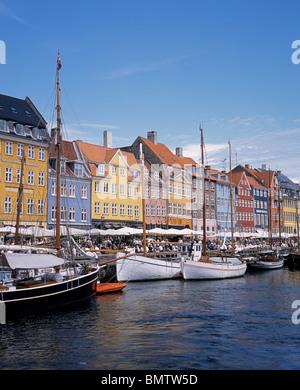 Colourful waterside buildings and old sailing ships, Nyhavn, Copenhagen, Hovedstaden, Denmark, Western Europe. - Stock Photo