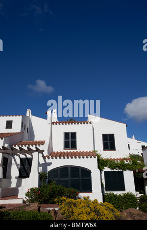 shuttered up luxury villa with blue sky background - Stock Photo